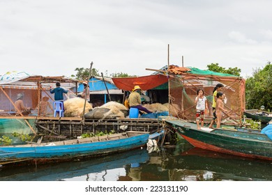 LAKE TONLE SAP, COMBODIA - SEP 28, 2014: Unidentified people in a Floating village Chong Knies on the Tonle Sap Lake, the largest freshwater lake in Southeast Asia, a UNESCO biosphere since 1997