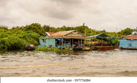 LAKE TONLE SAP, COMBODIA - SEP 28, 2014: Houses of a Floating village Chong Knies on the Tonle Sap. Lake Tonle Sap is the largest freshwater lake in Southeast Asia, a UNESCO biosphere since 1997