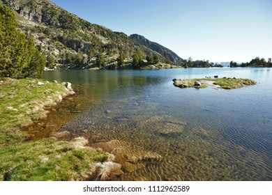 Lake Tort de Peguera with reflections from the refuge J. M. Blanc, Aiguestortes, Pyrenees, Lleida, Catalonia