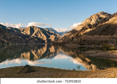 Lake Tortum, Turkey - Camping with green trekking tent at sunrise at Lake Tortum, Erzurum, Turkey