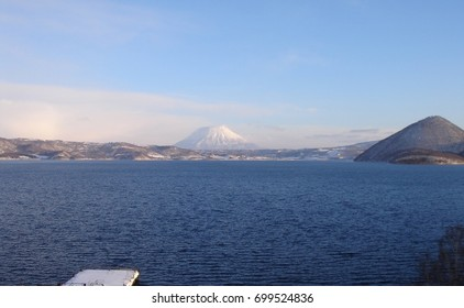 "Lake ""Toya"" and snow-capped Mt. ""Yotei"" in Hokkaido, Japan"