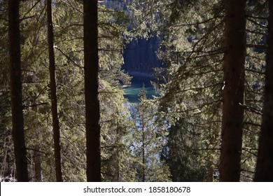 lake with transparent and reflective water with a mirror in the middle of the forest with mountains - Shutterstock ID 1858180678