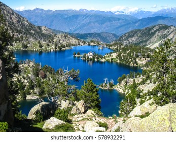 "Lake Trull and refuge ""Josep Maria Blanc"". ""Chariots of fire"" trail. Pyrenees mountain, Spain"