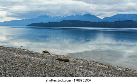 Lake in Vancouver surrounded by mountains reflecting in the water