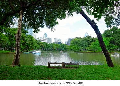 Lake view of Lumpini Park in the Thai capital's city centre on october 10, 2014 in Bangkok, Thailand. Lumpini Park covers 142 acres with 2.5 km of pathways and a large boating lake.