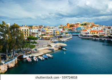 The lake Voulismeni in Agios Nikolaos,  a picturesque coastal town with colorful buildings around the port in the eastern part of the island Crete, Greece