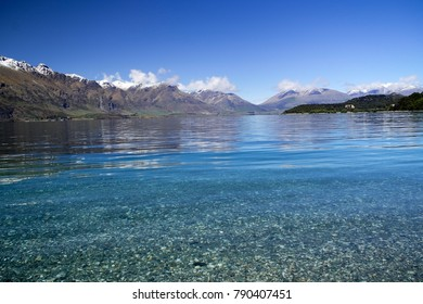 Lake Wakatiki with intense blue sky with snow capped mountains in the back, Queenstown, South Island New Zealand, November 2017,