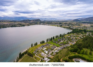 Lake Wanaka, New Zealand panoramic landscape from aerial view captured by drone flying above Wanaka City. Wanaka is a popular resort of New Zealand, and is much used for fishing, boating and swimming.