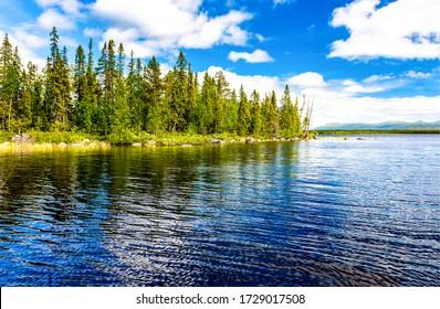 Lake water grass blue sky landscape