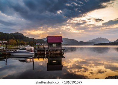 Lake wharf with a wooden pier at dawn. Teletskoye Lake, Artybash Village, Altai Republic, Russia