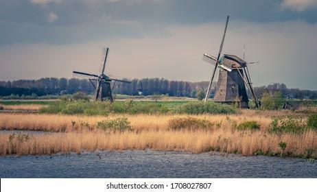 Lake Windmill Farm At Sunset
