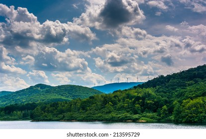 Lake and windmills on a mountain ridge in the rural Potomac Highlands of West Virginia.