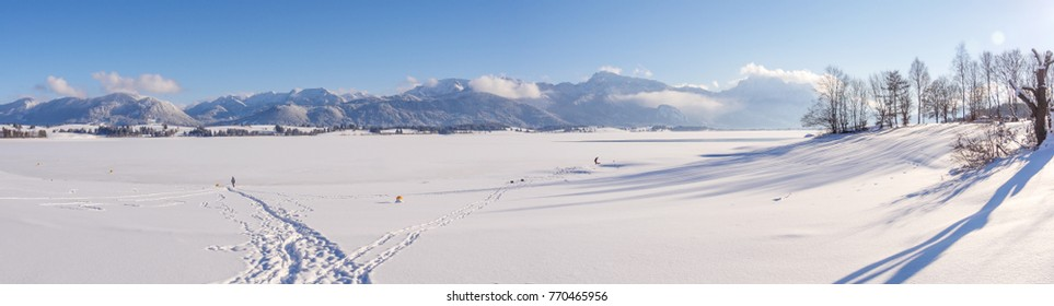 lake in winter with mountains