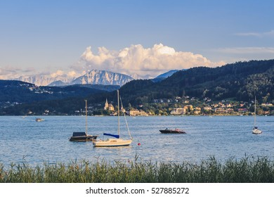 Lake Woerthersee in Carinthia with church Maria Woerth in the background, Austria