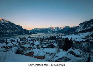 Lake Wolfgang See and Sankt Gilgen in Austria at sunset in winter.