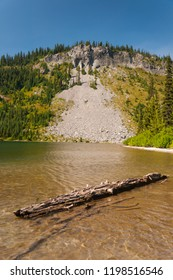 Lake, wood and hill at Mount Rainier National Park
