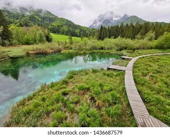lake with wooden trail in slovenia