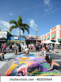 LAKE WORTH - FEBRUARY 24: Artists crate chalk drawing during the annual Street Art festival in Lake Worth FL on February 24, 2013