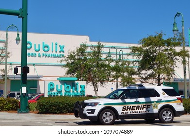 LAKE WORTH, FL -3 MAR 2018- View of a Palm Beach County sheriff police car in front of a Publix grocery supermarket store in Lake Worth, Florida, United States.