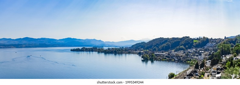 Lake Zurich in Wollerau, canton of Schwyz in Switzerland, Zurichsee, Swiss mountains landscape, blue water and sky in summer, idyllic nature and perfect travel destination, ideal as scenic art print.
