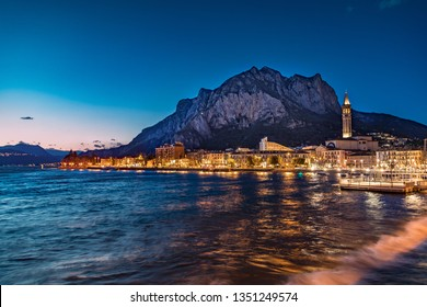 Lakefront of the city of Lecco at sunset.