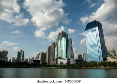 The lake-front office building with sky and clouds behind in Bangkok Thailand. This photo was taken on 15/6/2017.