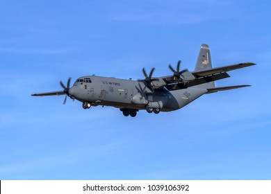LAKENHEATH, SUFFOLK, UK – FEBRUARY 16, 2018: US Air Force C-130J Hercules AF 15736 out of Ramstein Air Base in Germany makes its approach to land at RAF Lakenheath.