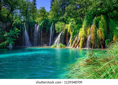 Lakes with blue water and waterfall in the middle of a mountain landscape. National Park Plitvice Lakes. Croatia.