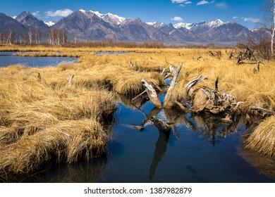 lakes on the background of mountains with snow peaks, Buryatia, Tunka valley, coimor lakes, Russia, Siberia