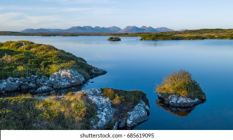 Lakes and trees with beautiful weather in Connemara national park near Roundstone, Galway, Clifden and Letterfrack. Travel to Ireland in Europe.