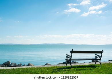 lakeside bench at october indian summer