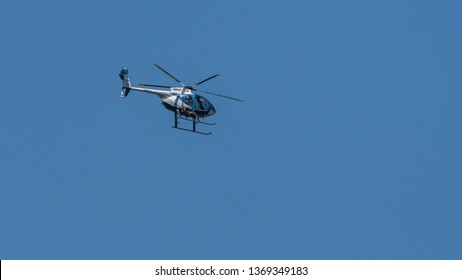 Lakeside, CA - April 13, 2019: A San Diego County Sheriff helicopter flies north of Lakeside, California as part of the department's Aerial Support to Regional Enforcement Agencies (ASTREA) program.
