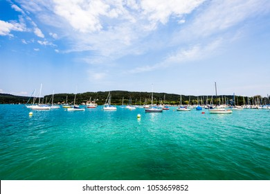 Lakeside Holidays. Great lake Klagenfurt am Wörthersee. The large lake of Klagenfurt in Austria. Many boats are anchored. Summer holiday resort of many European tourists. Crystal blue water.
