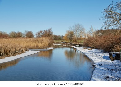 Lakeside landscape in winter with some snow
