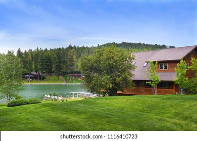 LAKESIDE, MONTANA, UNITED STATES - June 9, 2018: Cabins on two shores of Peaceful Bay on Flathead Lake