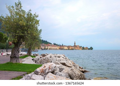 lakeside promenade salo village, garda lake italy. well known tourist destination.