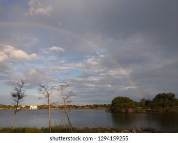 Lakeside rainbow and landscape