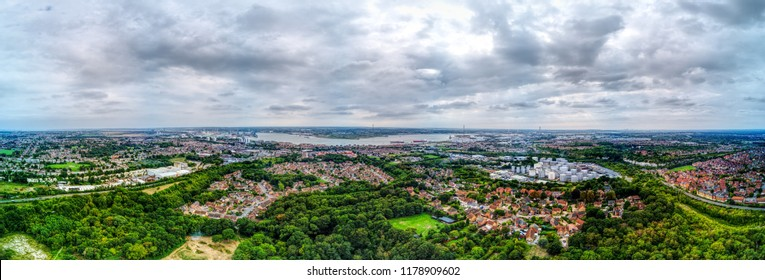 Lakeside, Thurrock, Essex, UK.  Panoramic over Chafford Hundred residential area.  Also visible are Tilbury docks on river Thames and shopping centre