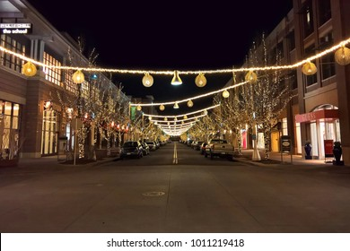 LAKEWOOD, CO - JANUARY 07, 2018: An empty night street scene donned by festive holiday lights at the Belmar shopping district in Downtown Lakewood, Colorado.
