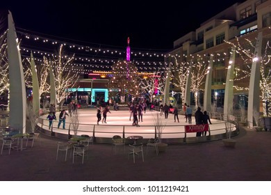 LAKEWOOD, CO - JANUARY 07, 2018: Ice skaters enjoy the outdoor holiday lights and ice rink at the Belmar shopping district in Downtown Lakewood, Colorado.