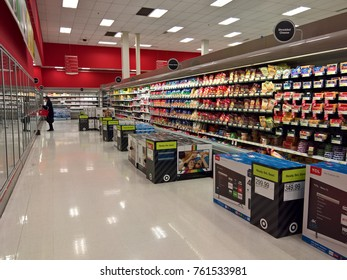 LAKEWOOD, CO - NOVEMBER 23, 2017: Television sets juxtapose grocery aisles at Target on Thanksgiving during Black Friday sales.  Crowds are thinner due to sales dates spread across the entire weekend.