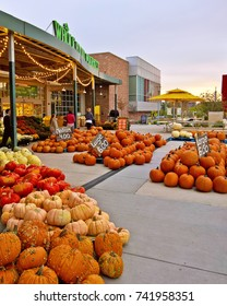 LAKEWOOD, CO - SEPTEMBER 29, 2017: A display of pumpkins in front of a Whole Foods Market marks the start of fall season and the upcoming Halloween holiday