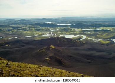 Laki rough volcanic landscape observed from top of Sveinstindur mountain. Skaftá river flow in front and Laki volcanic area including Laki mountain/crater behind the river.
