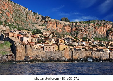 "LAKONIA, PELOPONNESE, GREECE. Impressive view of the medieval ""castletown"" of Monemvasia from the sea. Monemvasia is often called ""The Greek Gibraltar""."