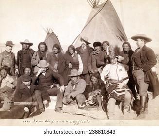 Lakota (Brule, Miniconjou, and Oglala) chiefs and U.S. officials in front of tipis at Pine Ridge Reservation. Pine Ridge, South Dakota. Photo by John C. Grabill. 1891