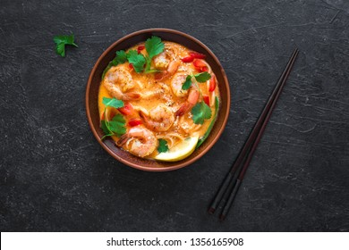Laksa Shrimp Soup. Prawn noodle laksa soup on black background, top view, copy space. Asian Malaysian food.
