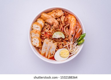 Laksa is a spicy noodle soup popular in the Peranakan cuisine of Southeast Asia. Laksa consists of thick wheat noodles or rice vermicelli with chicken, prawn or fish, served in spicy soup.