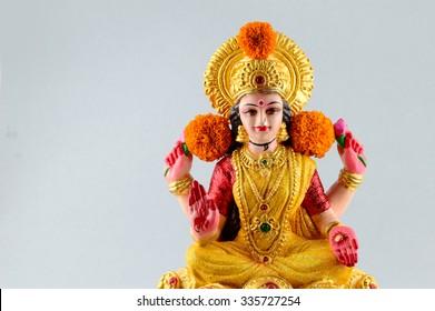 Lakshmi - Hindu goddess ,Goddess Lakshmi. Goddess Lakshmi during Diwali Celebration. Greetings Card Design Indian Hindu Light Festival called Diwali