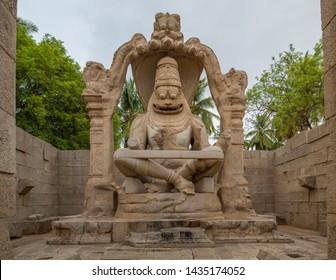 The Lakshmi Narasimha Statue in Hampi, India, on a early summer morning.