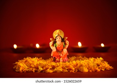 Lakshmi puja, Laxmi pujan, diwali oil lamp lit with statue of goddess Laxmi on lakshmi pujan or pooja in Diwali, Goddess Lakshmi